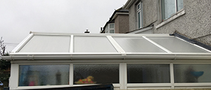 The cleaned conservatory, the white uPVC looks as it should.