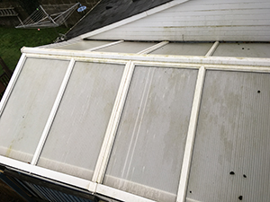 A green and dirty conservatory roof