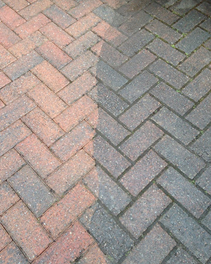 You can see the benefit of pressure washing dirty patio paving